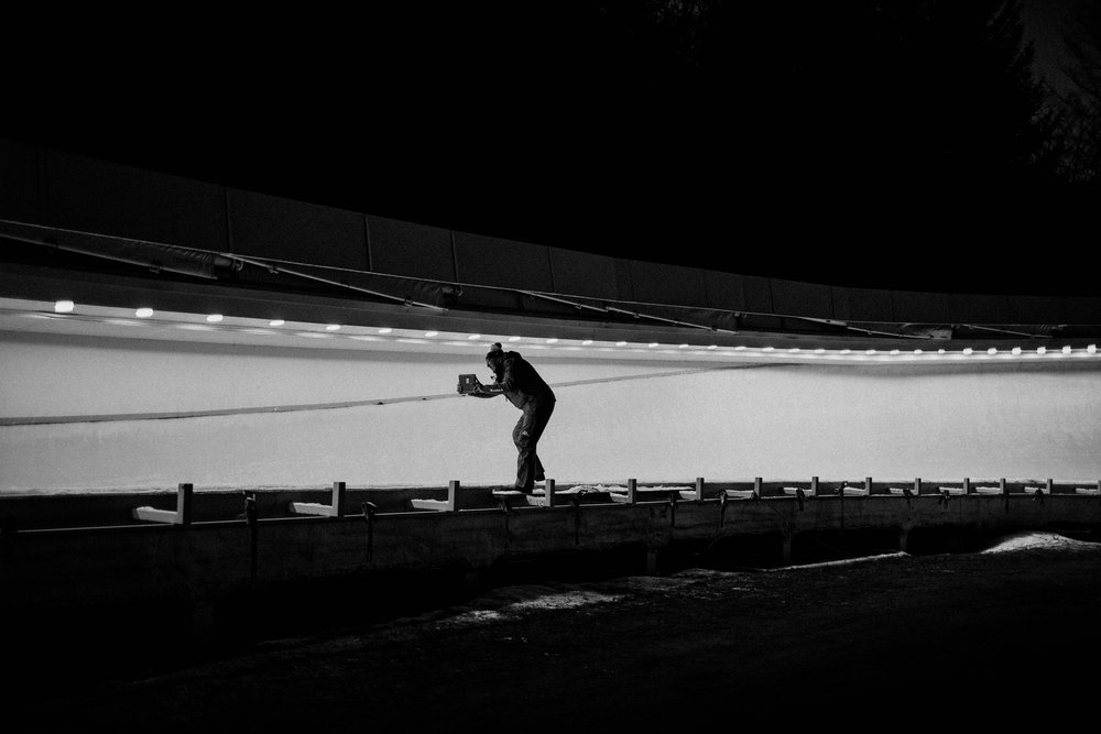 A member of the Italian team records a sled as it enters curve 10 on the track. The Lake Placid, New York track is known among athletes as one of the more technically challenging courses in the World Cup circuit. Olympic veterans and hopefuls in bobsled and skeleton gathered in Lake Placid, New York leading up to the World Cup Bobsled and Skeleton races held November 9-10, 2017. Results from Lake Placid, one stop along the circuit, will help determine teams for the 2018 Winter Olympics in Pyeongchang, South Korea.