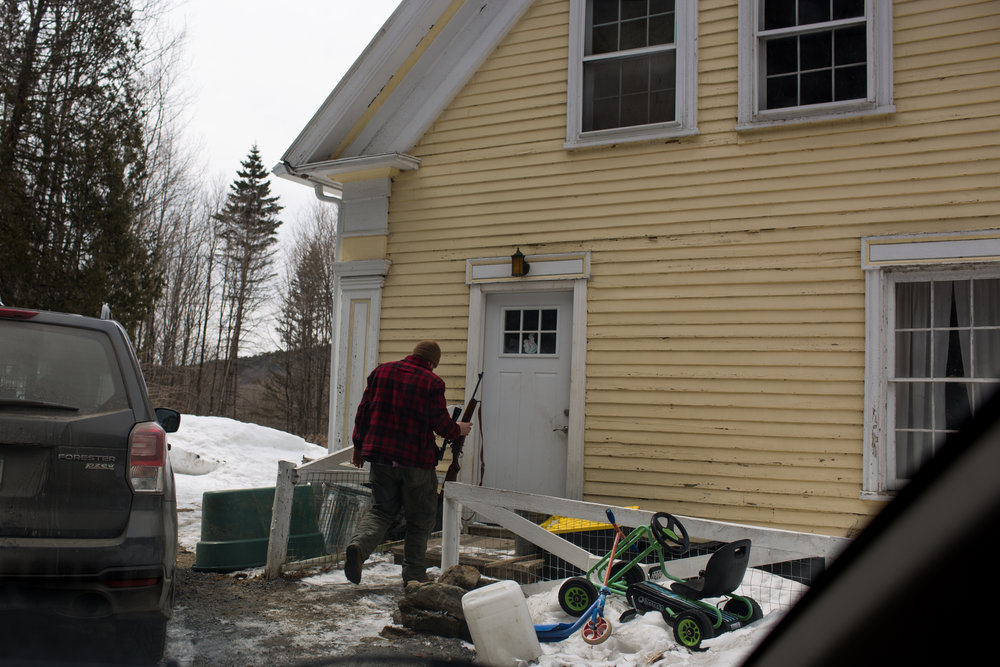 """Tom Galinat, 35, moved to Peacham, V.T., in 2013 to farm with his family on their land. A father of two as well as the town's clerk, Galinat says he is a gun owner who is in favor of what he calls common sense gun control. """"We need gun safety measures passed because we're abusing that,"""" he said. """"It's not the gun, it's the features of the gun. Like higher capacity magazines."""" For Galinat and his family, their livelihood relies on owning a firearm, hunting for food as well as its use on their farm in rural Vermont. He explained a gun is no different of a tool to him than a hammer or saw and he grew up with his grandfather using a gun to hunt. Galinat inherited his grandfather's Savage Fox Model D side-by-side two-trigger shotgun which was once used for bird hunting and is now brought out each year for opening day of turkey hunting. There is a sentimental attachment, he said, describing a worn out area on the stock where his grandfather's hand would grip. """"I don't want to give up my guns,"""" he said, following chores at his farm on Friday, April 7, 2018. """"I relate to both sides so well.""""John Tully for The New York Times"""