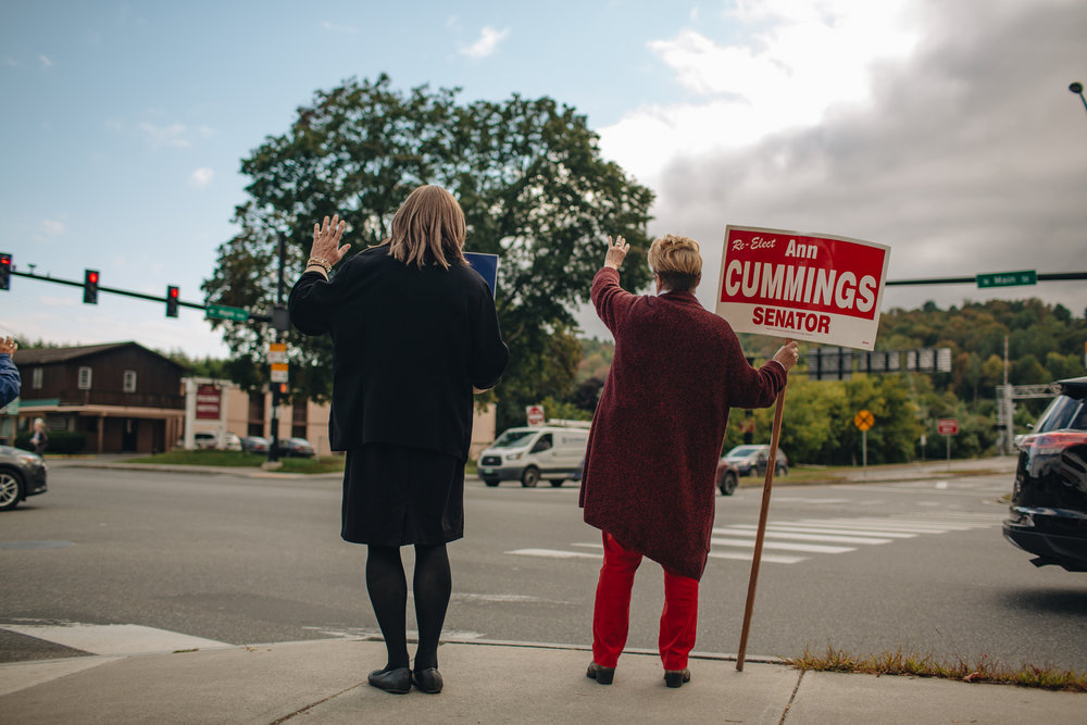 Christine Hallquist, left, a Democrat from Vermont running for governor, attends a Honk-and-Wave event at an intersection in downtown Barre, Vermont. Hallquist became the first transgender candidate to be nominated for a governorship by a major party after beating three candidates in Vermont�s primary. She and her campaign team worked throughout the northern part of the state on Monday, September 24, 2018.JOHN TULLY For The New York Times