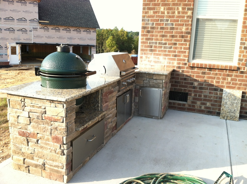 custom outdoor kitchen with big green egg and summerset grill