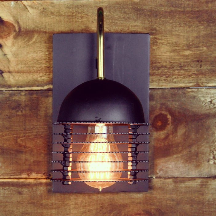 Clutch plate wall sconce