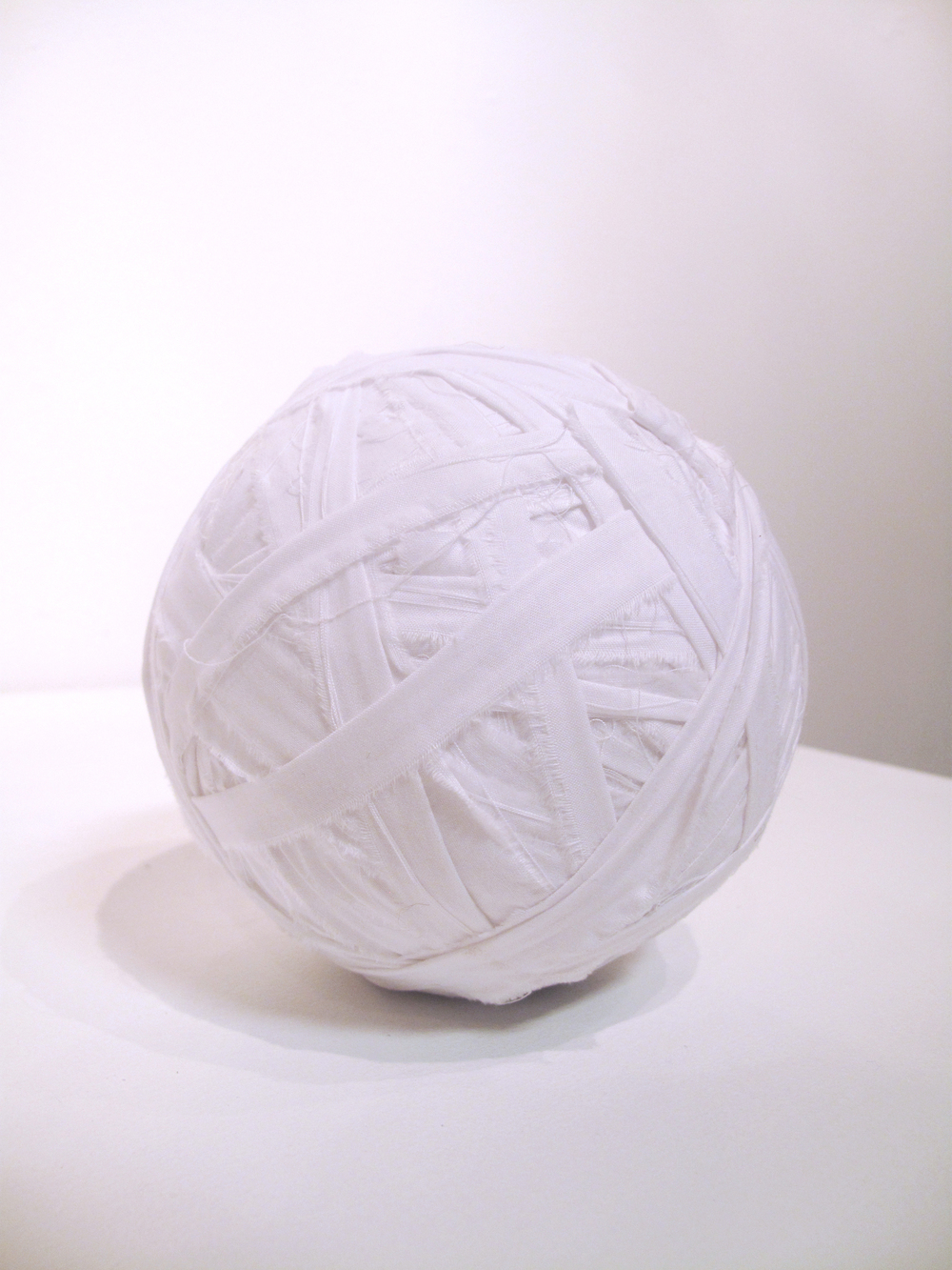 Yarns  is a series of memorials.   Twin Set , 2014.  Restructured bedding.  Apprx. 5 x 5 x 5 in.