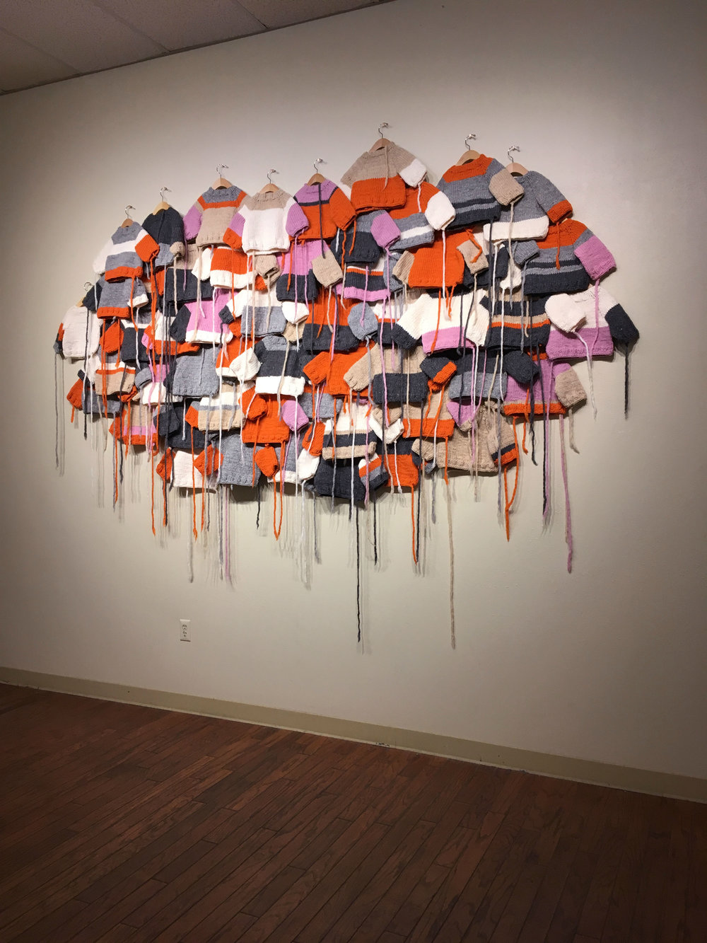 Kindred  captures a sense of mass, of horizontal overlay, of connection, of community. Via scale, color, and form it references lineage, influence, and relationships.   Kindred , 2018.  Wool, wood.  Apprx. 5 ft. x 8 ft. (dimensions variable).
