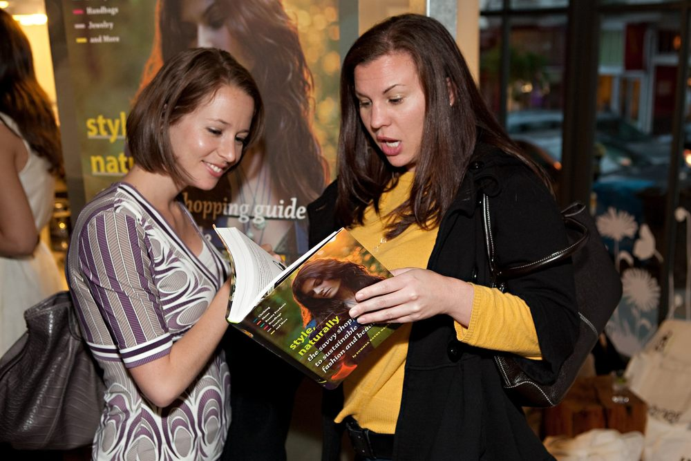 Guests at the SF launch party check out the book.