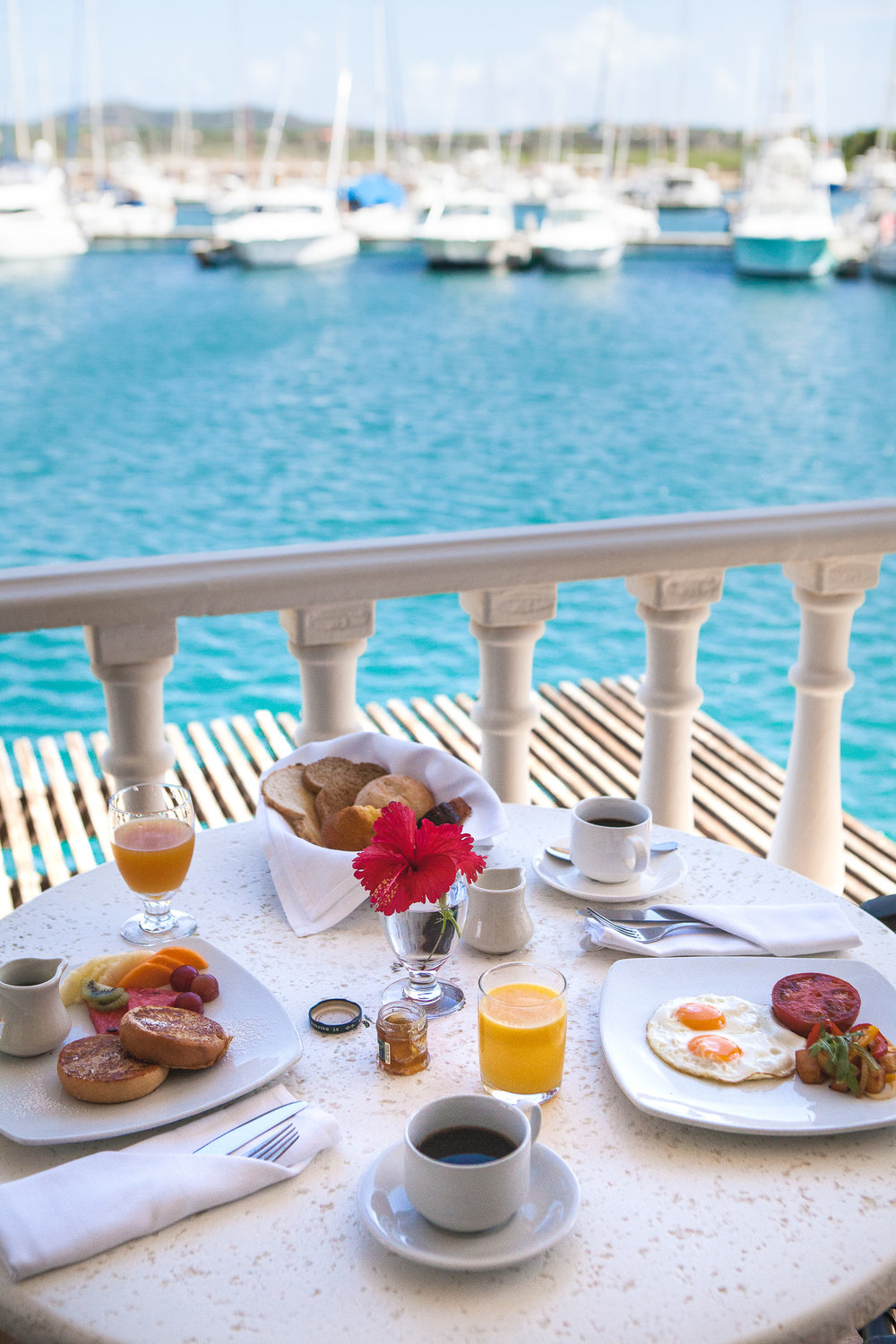 - Possibly my favorite part of staying at Harbour Village was starting each day on my balcony enjoying a slow breakfast overlooking the boats and yachts in the harbor. With average temperatures around 82°F / 28°C year round, even with a slight breeze, it was always comfortable being outside.