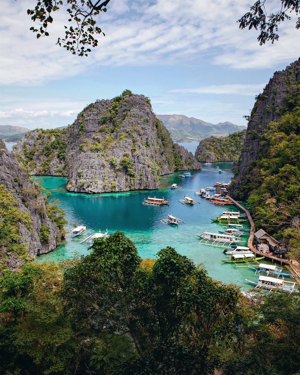 Coron - There are endless natural wonders near Coron accessible via bangka (outrigger boat), available for private rentals or through a tour. The popular Kayangan Lake is a salt and freshwater lake entirely enclosed by Palawan's massive limestone cliffs. Other swimming holes nearby included Barracuda Lake (less crowded but just as beautiful) and Twin Lagoon (clear, calm waters–perfect for swimming)