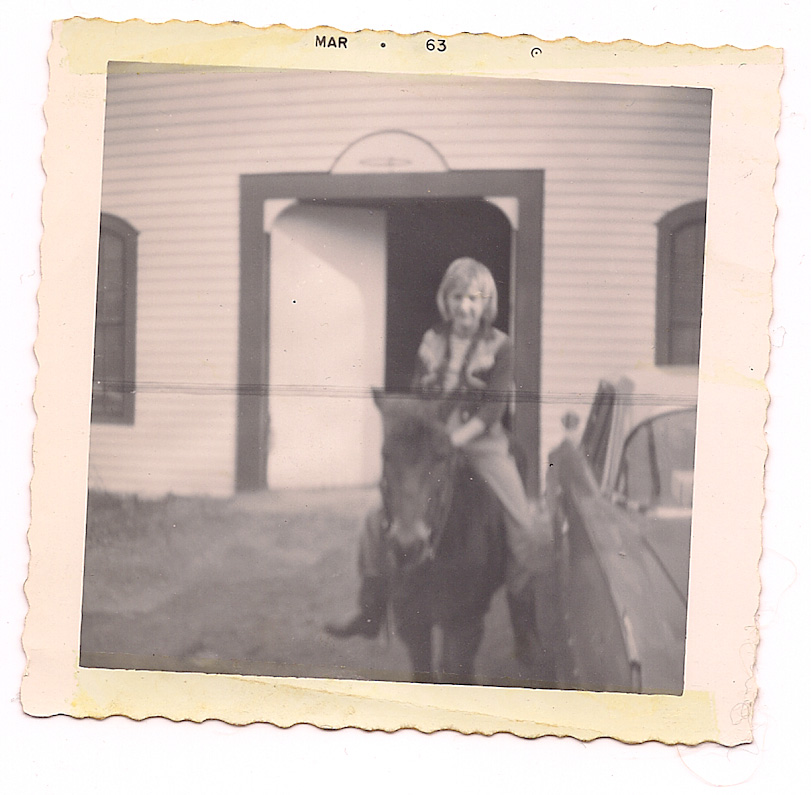 CJA with Jimmy the pony, the spring after he arrived into our lives.