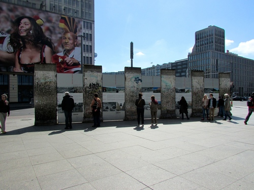 Remnants of the Berlin Wall stand as an outdoor exhibit in the middle of Potsdamer Platz