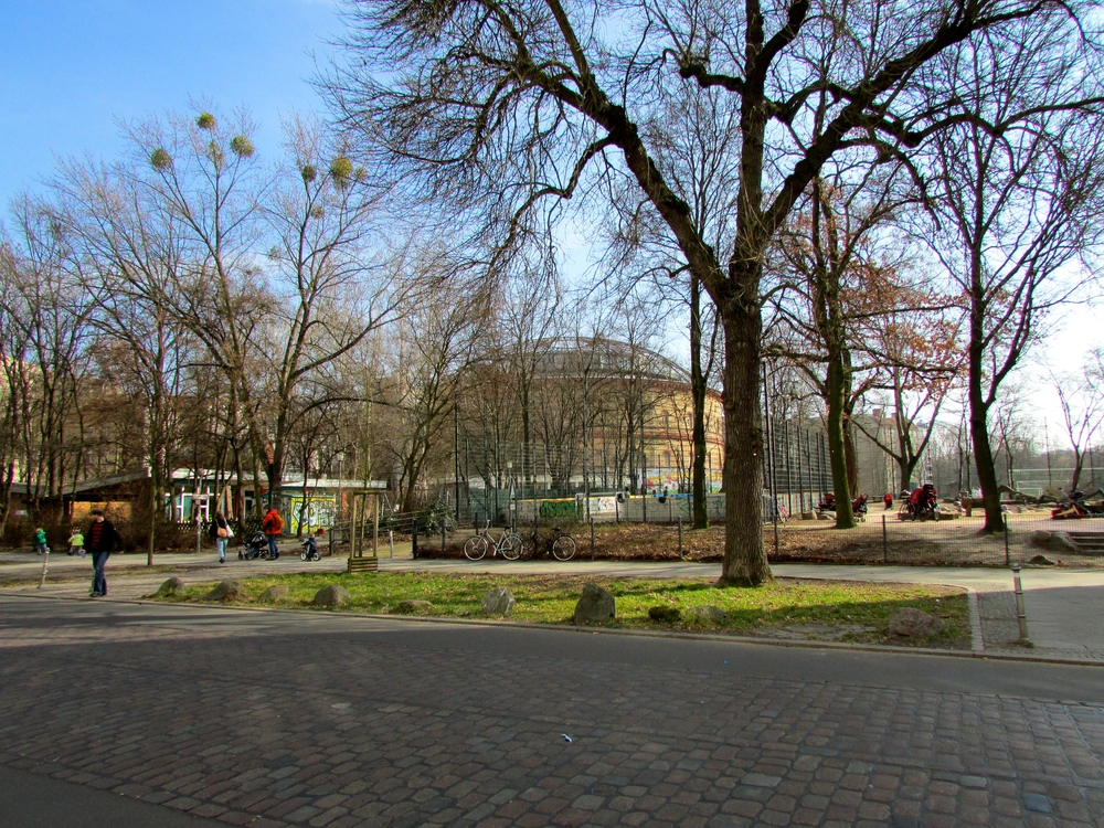 The bunker and its distinct dome can be seen in the background of the picture, behind soccer fields and a children's park.