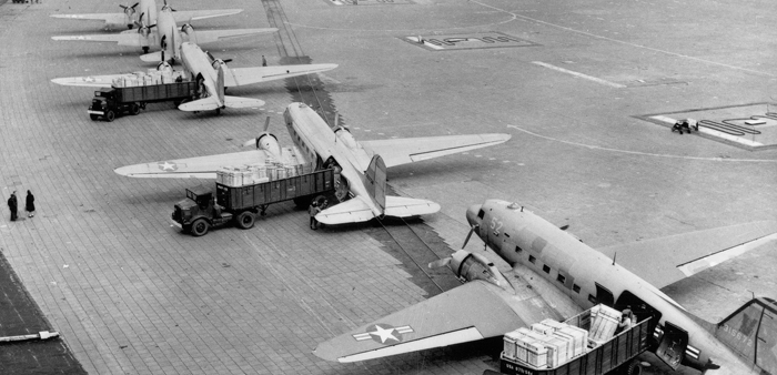 Trucks transport the planes' goods from the airport to the residents of West Berlin. Image Source