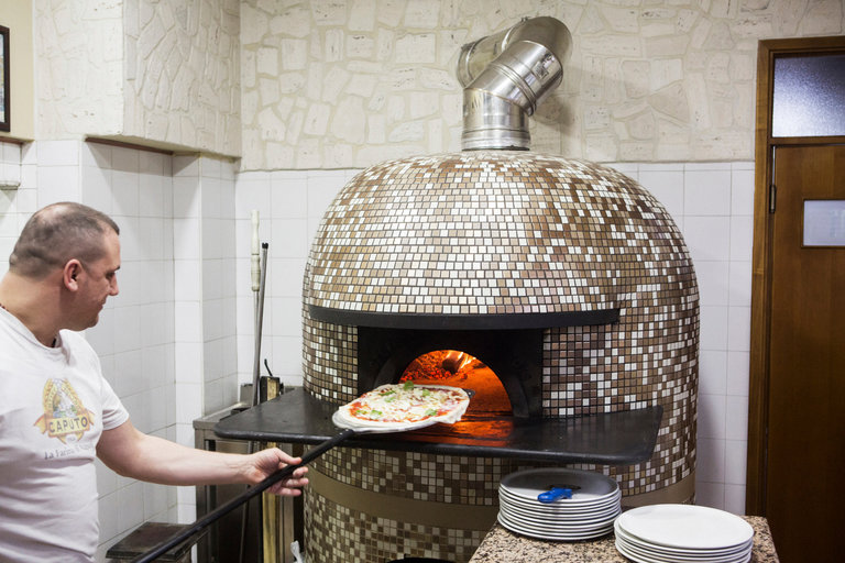 Photo 1: Pizza maker in San Vitaliano.  Source: New York Times.