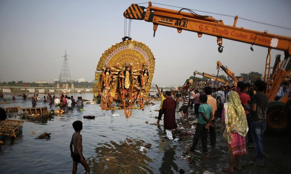 "The Ganges River. Qadri, Atlaf. & AP. ""Durga Puja festival on the Yamuna river, one of the rivers granted status of living human entities by the Uttarakhand court."" Found, The Guardian, 12 June 2017, https://www.theguardian.com/world/2017/mar/21/ganges-and-yamuna-rivers-granted-same-legal-rights-as-human-beings."