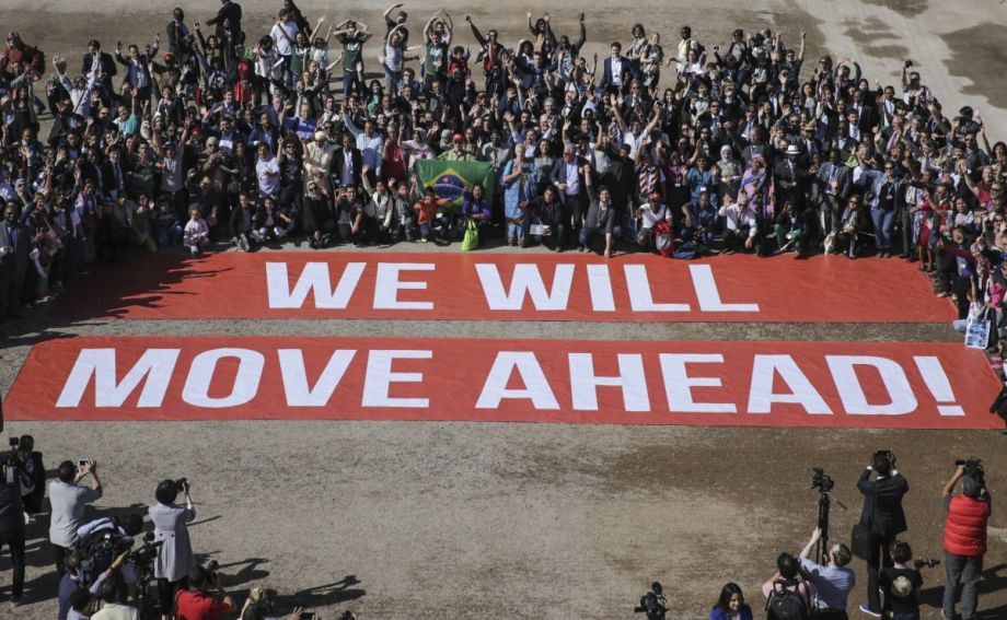 Participants at  COP22 , a follow-up on the Paris climate agreement, stage a public show of support for climate negotiations in Marrakech, Morocco, on Nov. 18. (AP Photo/David Keyton)