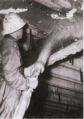Dangerous attempt at asbestos removal. Disturbance of asbestos results in toxic flaking.  Source:  Flikr