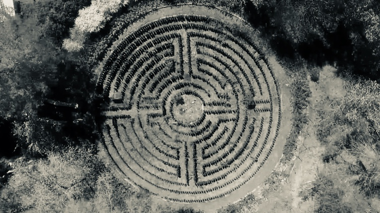 Labyrinths are networks of paths that can be disorienting, also create illumination and reflection during the navigation process. (Edited image from still of footage by Coty Batemon)