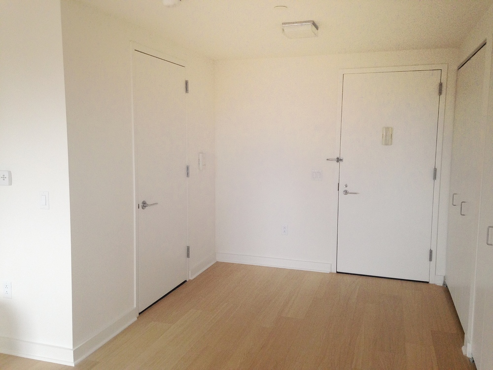 Entry Way: Bathroom on Left, Closets on Right
