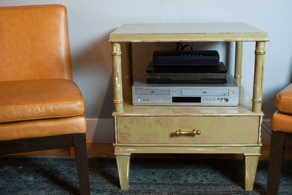 Pea green side table with gold detail