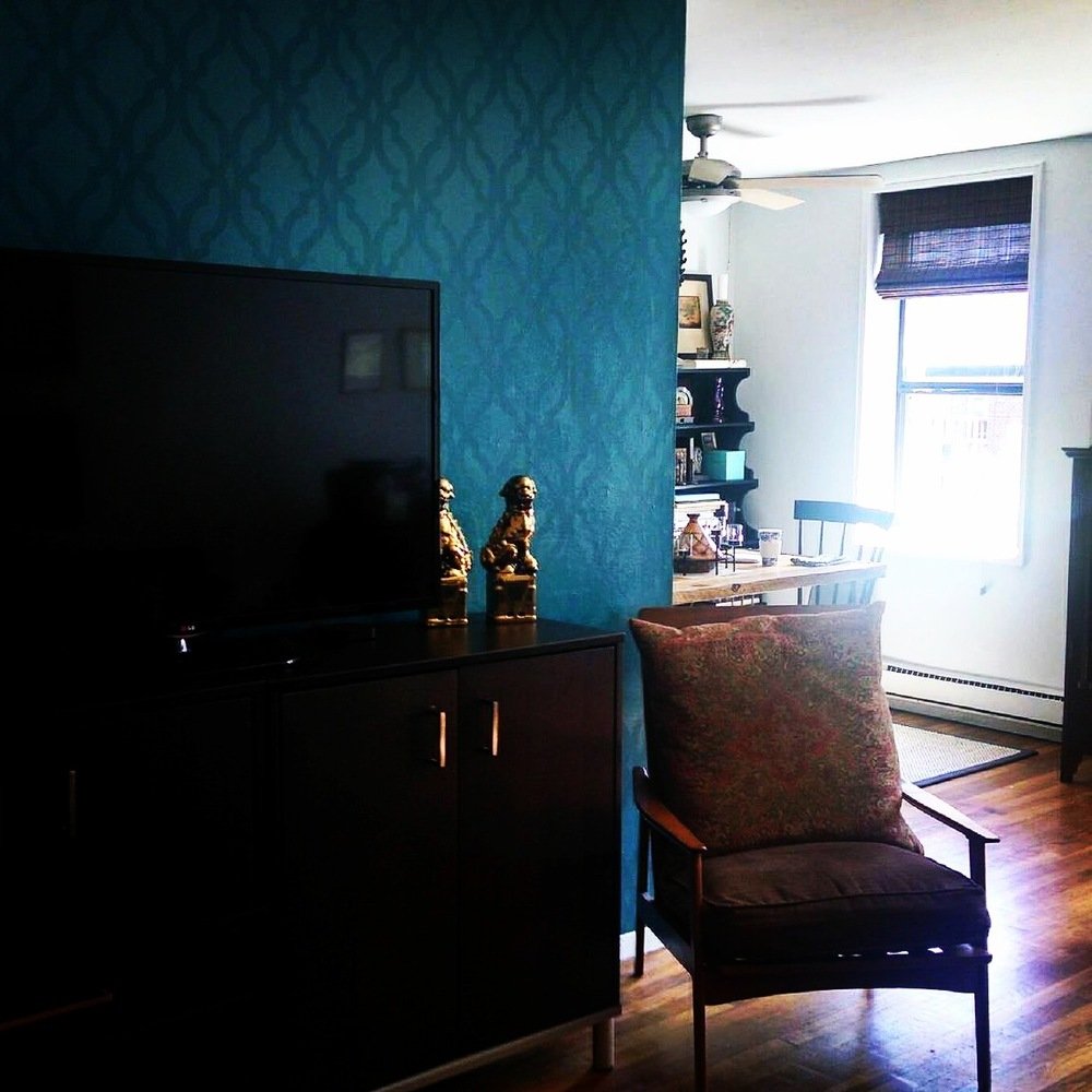A beautiful Teal accent wall with an allover stencil.