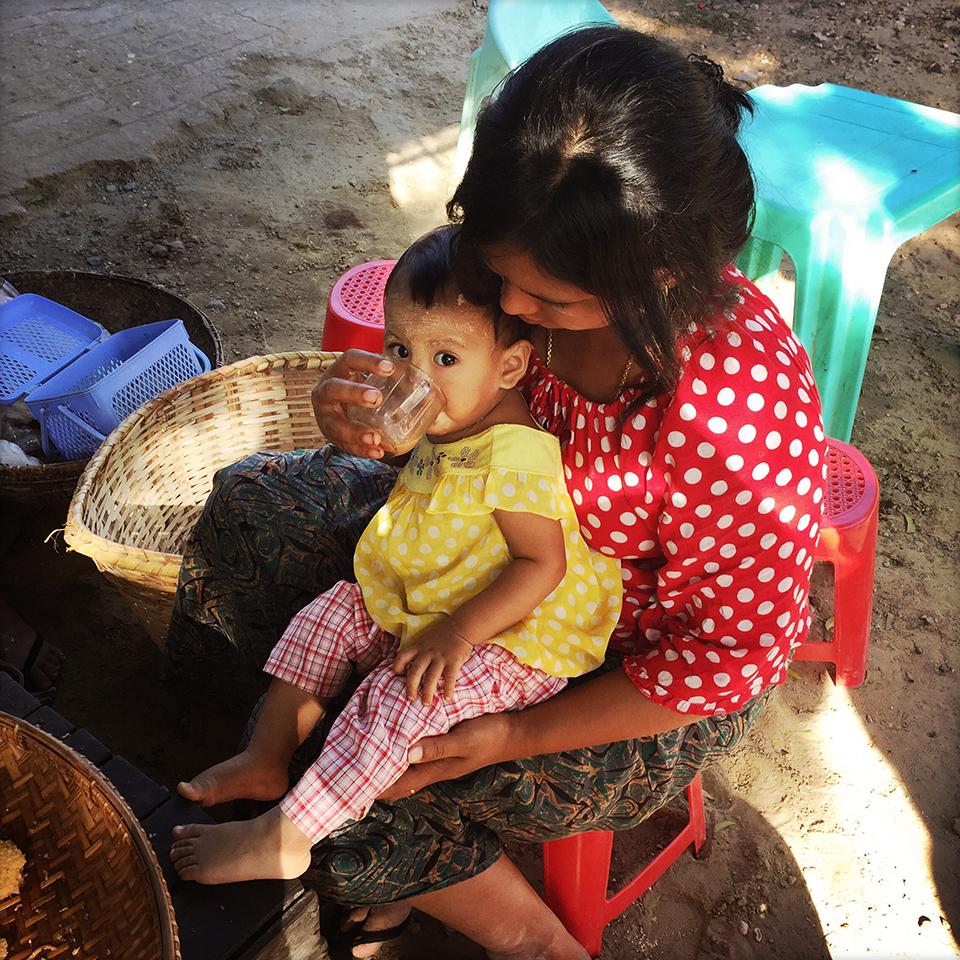 New Bagan, Myanmar — Toddler drinking lapaeyae (milk tea).