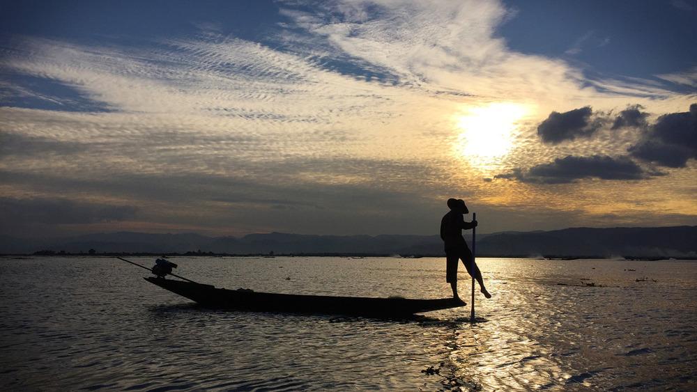 Inle Lake, Myanmar – Fisherman steering with one leg.