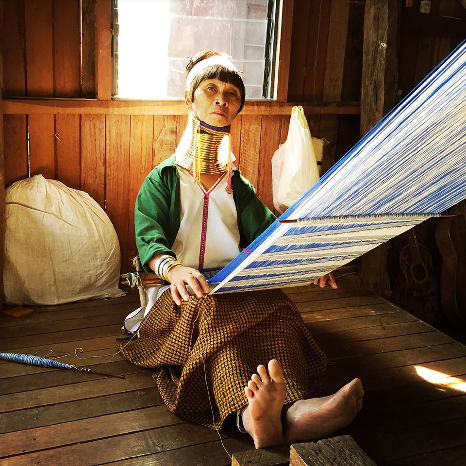 Ywama, Inle Lake, Myanmar. – Kayan woman weaving.