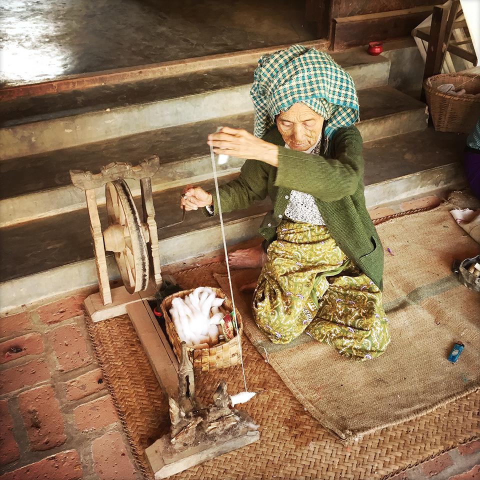 Minnanthu village, Bagan, Myanmar – Spinning cotton.