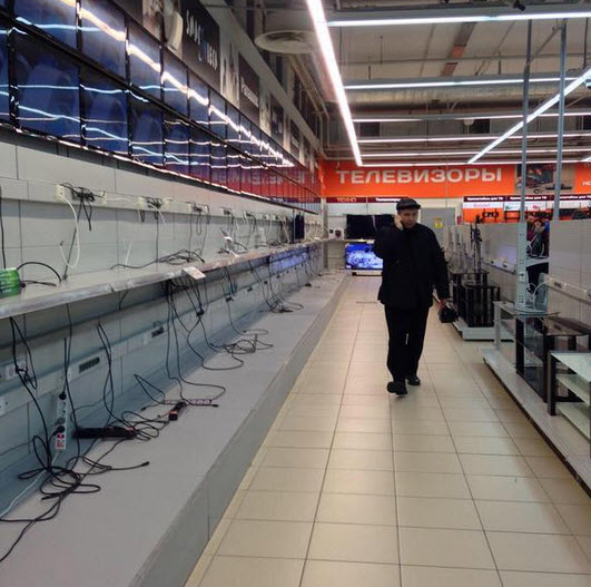Shelves emptied at a local electronics store as Belarusians rush to swap their cuirrency with foreign made goods