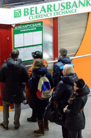Locals queue up outside Belarusian Bank to withdraw local currencyas run on banks continue