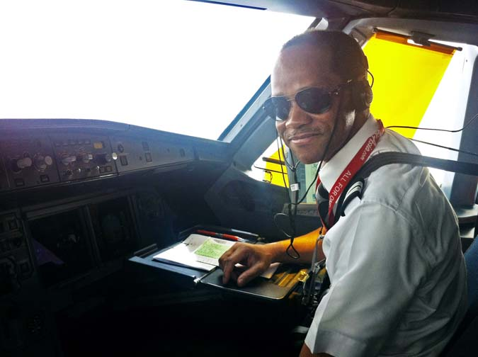 First Officer (Co-Pilot) of Flight QZ8501, Rémi Emmanuel Plesel, is picture in shades inside the cockpit of a AirAsia Indonesia airpane