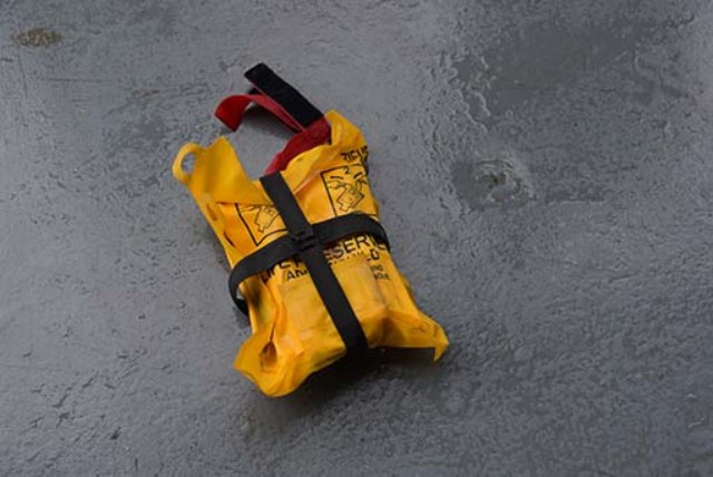 An adult life jacket and three personal items believed to be from the wreckage of AirAsia flight QZ8501 picked up by the crew of the RSS Valour, was brought on board the MV Swift Rescue on Sunday at 1.15am