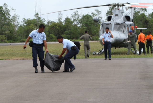 7 bodies from QZ8501 have arrived at Pangkalan Bun airport. One more is on its way from a Malaysian ship, flown in by a Super Puma helicopter. Channel NewsAsia's Xabryna Kek who is on the scene says there appears to be debris being shifted from the choppers as well