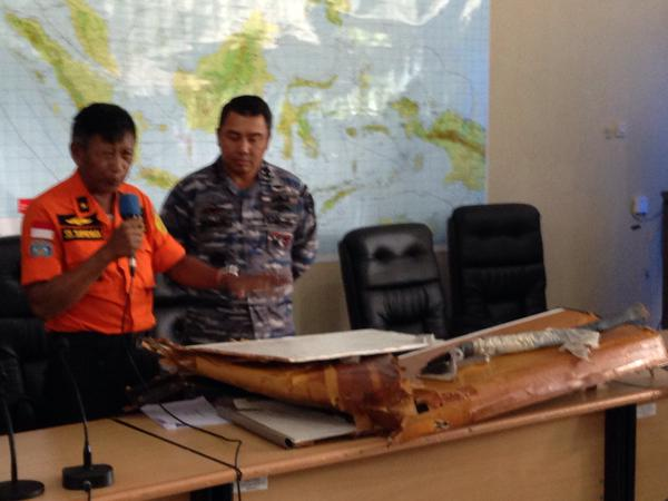 SAR officials display debris of   QZ8501. They indicated that they are close to finding the plane's wreckage