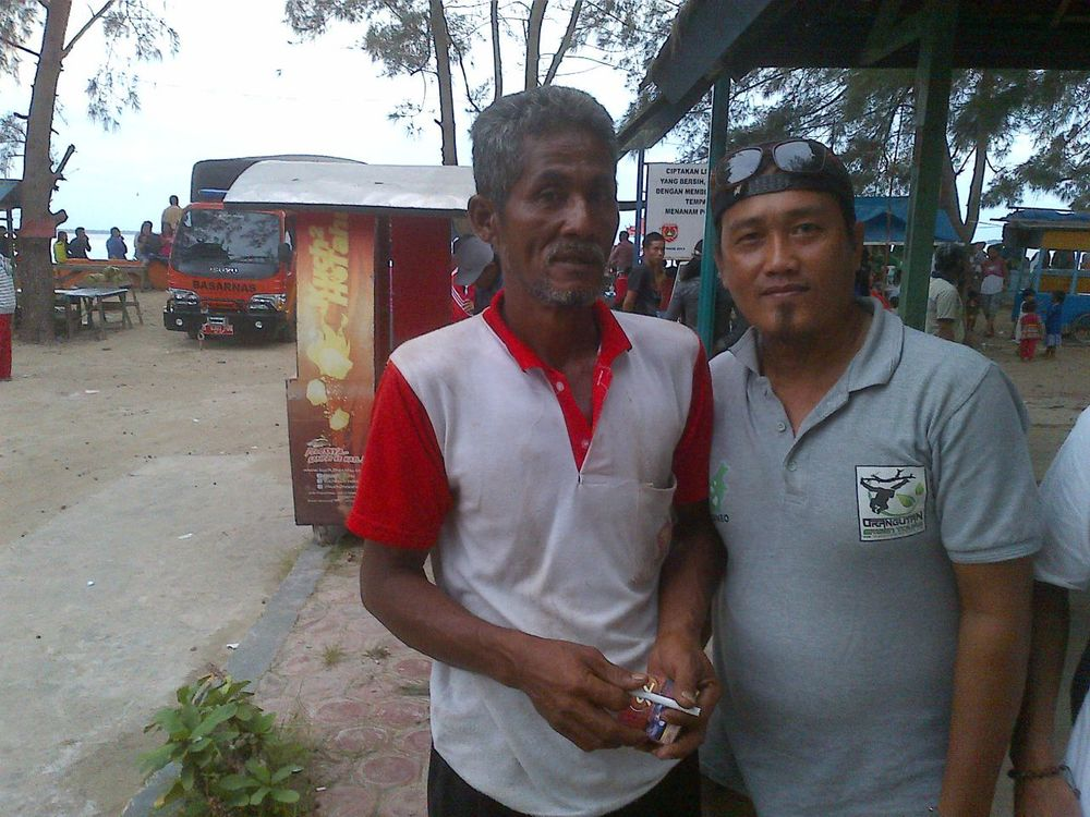 "Fisherman Mr Pendi (below, left) said he saw a plane flying ""really low"" on Sunday (Dec 28), the day AirAsia QZ8501 went missing. He had been renovating his roof at the time. He is now in Jakarta trying to assist with investigations. Other fishermen our reporter Xabryna Kek spoke with said it was raining heavility that day, with strong gusts of wind from 5am"