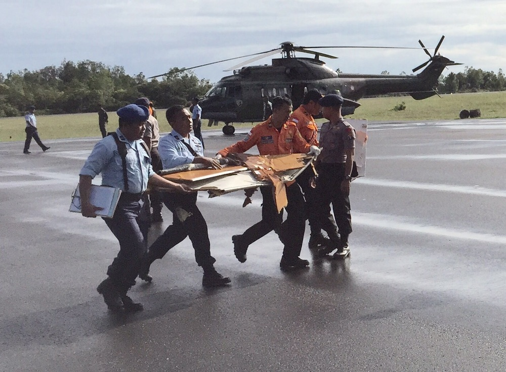 Four more bodies have arrived at Pangkalan Bun via a US Seahawk helicopter from the search site