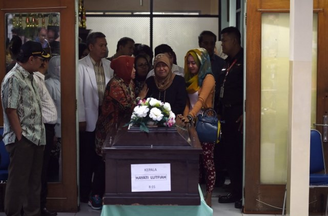 Passenger Hayati Lutfiah Hamid is the first victim to be returned to her family.Her body, in a dark polished casket topped with flowers, was handed over to her family at a brief ceremony at a police hospital in Surabaya, the Indonesian city where the plane had taken off