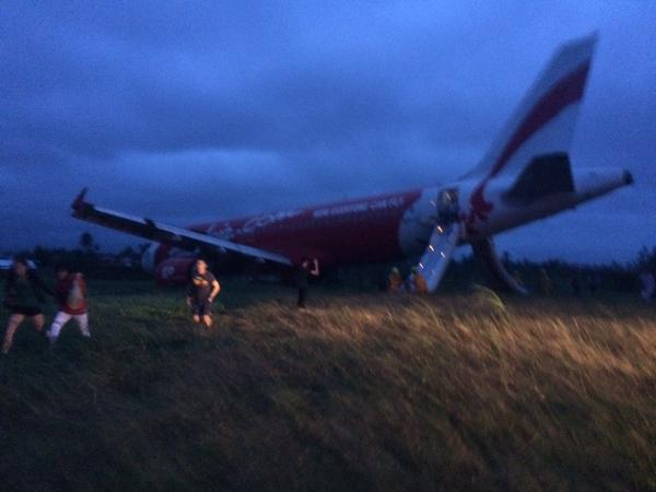 An AirAsia plane in Kalibo, Philippines overshot the runway, and passengers had to deplane using an emergency slide, according to one of the passengers