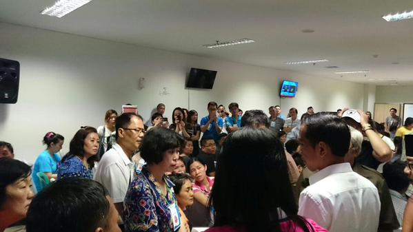 Indonesian President Joko Widodo met with relatives of those on board QZ8501 at the Surabaya Crisis Centre, hours after he got on a C-130 aircraft to inspect search operations at the debris site near Pangkalan Bun