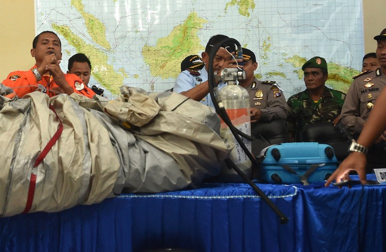 "An Indonesia pilot on a C-130 Hercules aircraft said he spotted seven to eight bodies in the water, and three of them were ""holding hands"", reports Kompas. Luggage was among the debris picked up from the waters in the Karimata Strait today"
