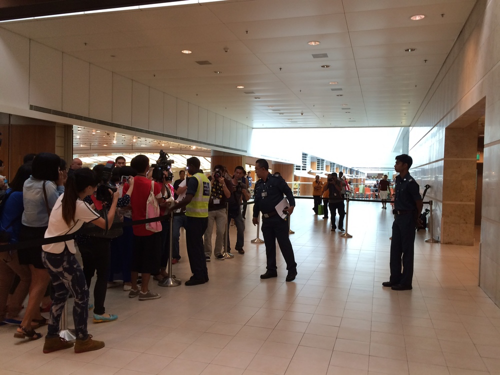 Relatives of AirAsia QZ8501 passengers arriving at Changi Airport Terminal 2 are being ushered into a cordoned-off waiting area. A press conference is also expected to be held here soon