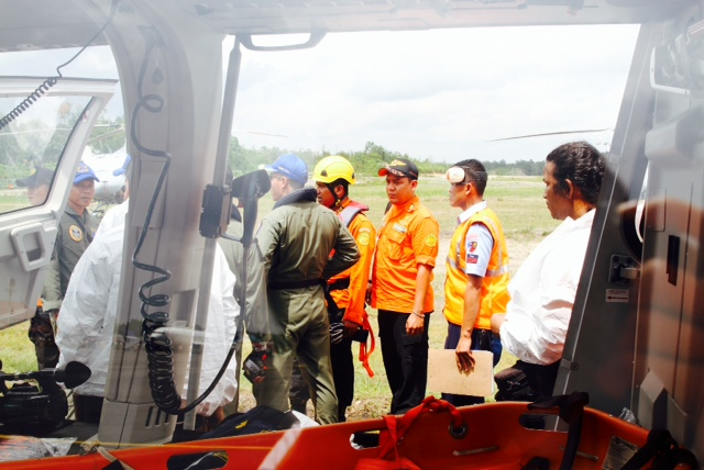 Indonesia's search and rescue agency BASARNAS sends personnel to retrieve two bodies found in the search operation