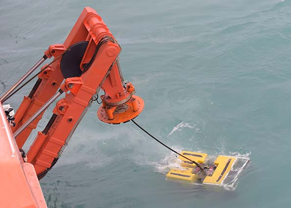 Singapore's MV Swift Rescue launched a Remotely Operated Vehicle in a new search sector today, surveying an area where the fifth aircraft part from QZ8501 is believed to be located. Although conditions on the surface were better than previous days, strong currents beneath the surface meant visibility underwater was less than a metre