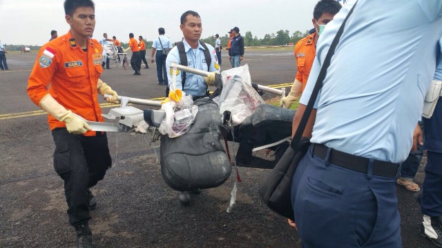 A mangled passenger seat has been recovered during the search, and transported to Pangkalan Bun