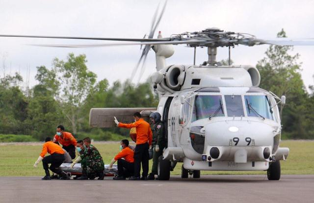 apanese helicopter crew flew in an additional two bodies to Pangkalan Bun, bringing the total body count to 44