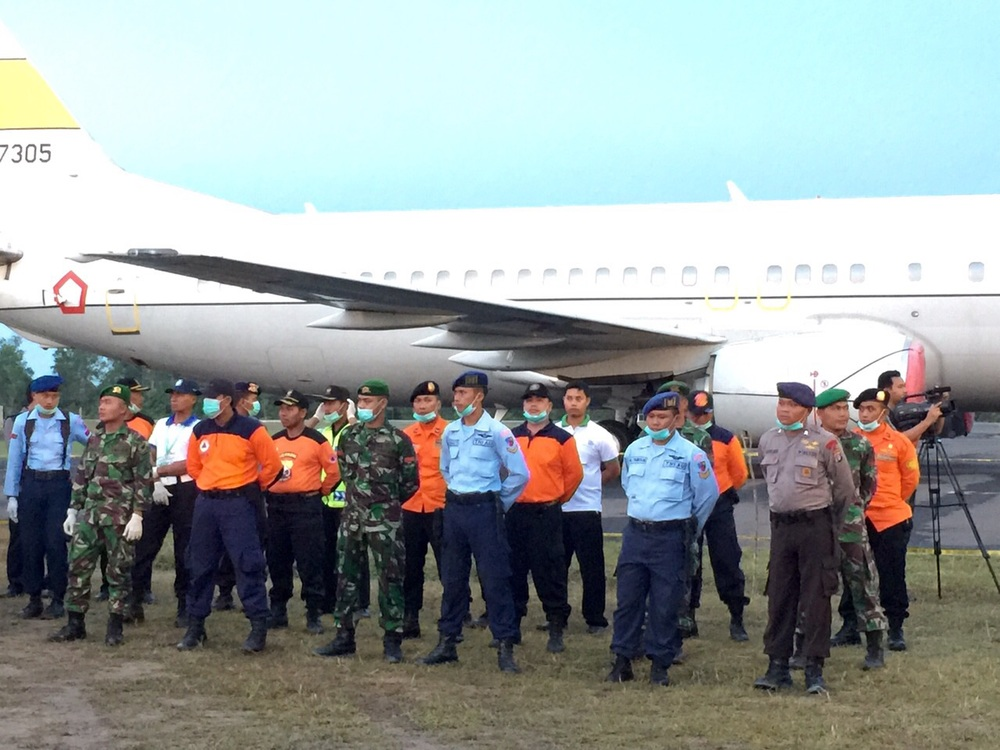 A ramp ceremony is currently underway for seven victims of #QZ8501. Each was brought back to land today