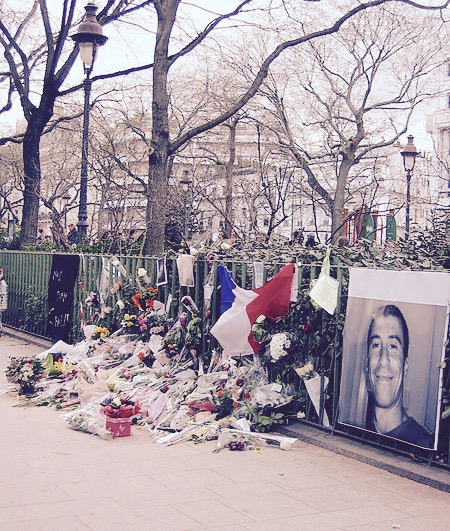 A memorial of Ahmed Merabet  in Paris, France; he was one of the 3 national policemen who died as a result of trying to stop the assailants in their rampage. He has been awarded with the  Légion d'honneur    by French President François Hollande for his service