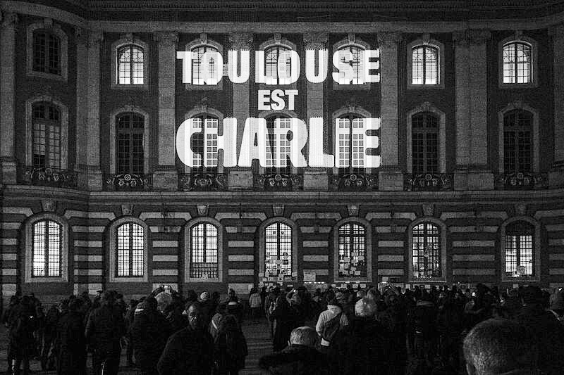 Charactered lighting shines on a building in Toulouse, Southwestern France in remembers de to those who died in the Charlie Hebdo shootings