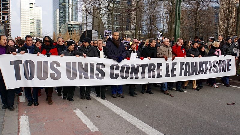 "Street rallies are held in Brussels, Belgium on the day following the killing of 12 staff of the Charlie Hebdo Magazine in Paris. The banner reads ""United against all fanaticism""; apparently referring to the Islamic roots behind the brutal attacks of the 8th January"