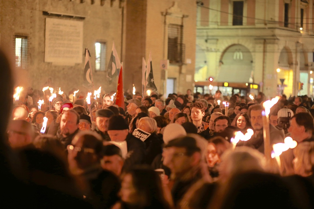 Also in Bologna, Italy, supports carry lighted torches on the night following the initial attacks on Charlie Hebdo; they seem to iterate that Europe doesn't take attacks on their mostly free press sitting down