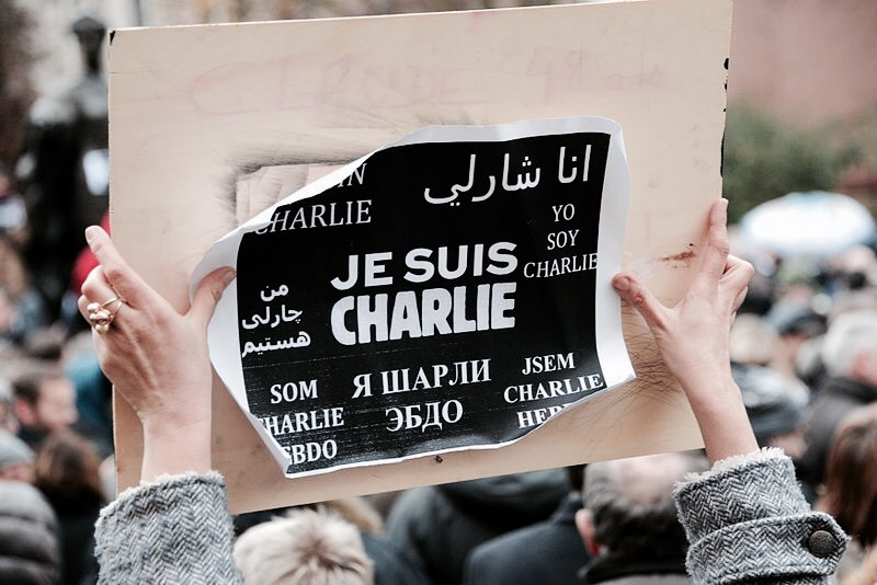 "Supporters fill the streets in parts of Luxembourg the day after the 8th January shootings. A woman raises a sign that reads ""I am Charlie"" in various languages; again in staunch support of Europe's free press"