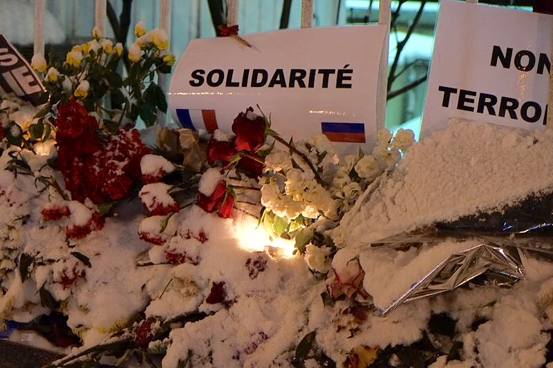Covered in snow, flowers serve as a memorial outside the French embassy in Moscow, Russia; in remembrance of the 12 who died in the Charlie Hebdo shootings on the 8th January